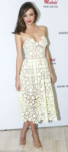 Lovely in lace! Earlier in the day, Miranda chose a low-cut cream Self-Portrait lace dress