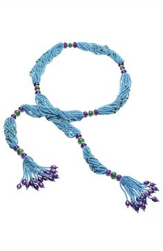 Bulgari – High-scarf necklace jewelry with turquoise thread, amethysts, emeralds and white gold pieces with pavé diamonds. Photo courtesy of Bulgari