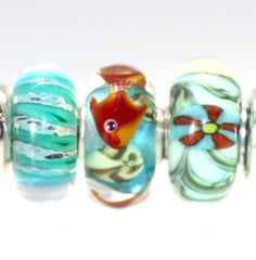 Trollbeads Gallery - Twins & Trios! Just listed with a great fish Trollbead unique! http://www.trollbeadsgallery.com/twins-trios-244/