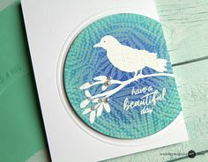 Ink Layering Video by Jen McGuire - white pigment leaves (Blvd day stamp) over blended Distress inks (blues) over white pigment circles of dots (bckgrnd stamp)