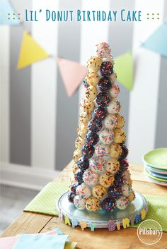 A birthday cake for donut lovers! Cover a foam cone in plastic wrap, then make a pattern with Pillsbury® Funfetti® Lil' Donuts (use toothpicks to hold them in place). #lildonutspromo
