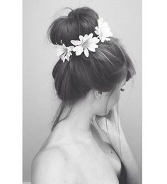 Messy bun accented with flowers.