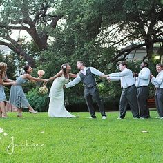 tug of war - cute bridal party pose after wedding.