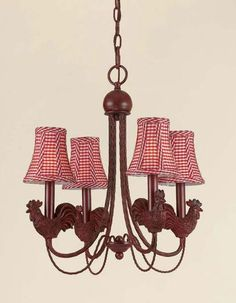 Antique iron roosters with red checkered shades complete this charming chandelier. The graceful lines of this lighting fixture make it a true statement piece.