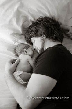Dad with newborn.   © Sarah Boccolucci Photography