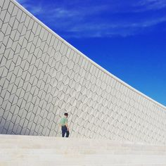 "The Man with a Hat and the Building with Scales. Maat (Museum of Art Architecture and Technology) ""scales"" façade detail.  Gathering Art, Architecture and Technology, this museum on the Lisbon Waterfront  is one-of-a-kind. Starting with its architecture. #maat #amandalevetearchitects #contemporary #architecture #art #technology #belem #lisbon #lisbonwaterfront #lisbontailoredtours #lisbonwithpats"