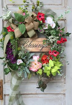 I love the Vibrant Colors in this One :)! This Wreath is made on a Grapevine Base. I have Layered it with Orange Hydrangea, a Large Pink Peony, Red Cosmos, Queen Annes Lace, Chartreuse Greenery, Purple Lilac, Eucalyptus, Sage Herb, Fern and other Spring Flowers and Greenery. This