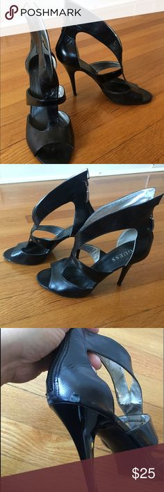 GUESS Black Strap Sandals Strappy high heel shoes. Please note that one of the shoes have a scuff mark. Guess Shoes Heels