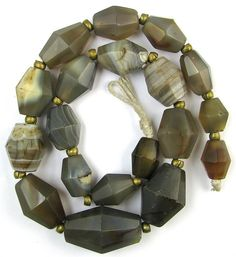 Old RARE Faceted Large Grey Agate Stone Mali African Trade Beads 19 Beads | This is a fantastic strand from my collection. A STRAND OF 19 OLD RARE LARGE FACETED LONG BICONE SHAPE GREY BANDED AGATE STONE MALI AFRICAN TRADE BEADS.  These beads have the nice worn feel to them which you only get with the old beads like this strand. This style of beads are getting much harder to find in the markets today. Very nice for collectors or jewelry designers. #tradebeads
