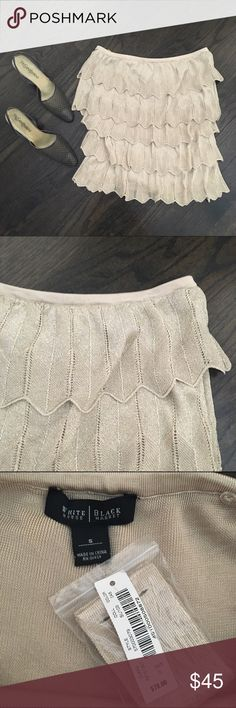 WHBM Gold Tiered Pointella Strapless Tank Top White House Black Market gold tiered pointella tank top. Can be worn with or without the straps. Dress it up with winter white or black pants, or wear it with jeans and heels for girls night out. Size small. Brand new. White House Black Market Tops Tank Tops