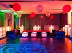 What's better than styling an event at an amazing venue like Apella's modern lounge? Creating two parties in one! Ryan and his friends danced under a funky lighting design and lounged beneath oversized balloons while the adults enjoyed a colorful and casual, retro-inspired cocktail party. The teen VIP lounge area - complete a projection of the event's logo, draping and cubbies for the kids - sported LED cube and hi-top tables, lucite stools and custom designed and printed lamps.