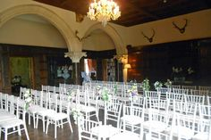 Great Hall - set up for a ceremony with chivari chairs - Huntsham Court
