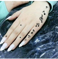 Simple Designs Discover Musical notes tattoo henna patterns Music is life! Cute Henna Tattoos, Henna Inspired Tattoos, Henna Tattoo Designs Simple, Henna Designs Feet, Finger Henna Designs, Mehndi Designs Book, Henna Tattoo Hand, Mehndi Designs For Beginners, Mehndi Designs For Girls