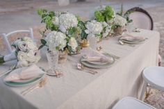 The tiny gold-painted animals are a much-welcome addition to this neutral table — as are the bright splashes of green. See the rest of this ethereal styled shoot at Inspired Bride.   - HarpersBAZAAR.com