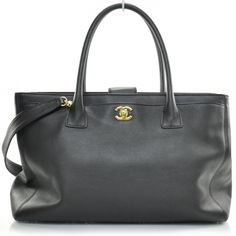 This is an authentic CHANEL Caviar Cerf Executive Shopper Tote w Strap in Black GHW.   This is a classic shopper tote that is simple yet sophisticated and very chic.
