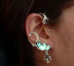 This lovely and so feminine ear cuff is perfect for the one who loves Celtic style with a touch of glow in the dark, a lovely ear cuff for romantic ones. There is a small Wind Dragon Cross suspended at the end of the ear cuff, two small zircons are applied on it.