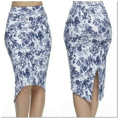 Floral Midi Skirt #403-L Navy floral midi skirt with slit in the back. 60% Rayon 35% Nylon 5% Spandex. Hommage Skirts Midi