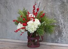 Simplistic and charming the pines mixed with white hydrangea blooms pops of red by BloomNation local florist, Roger's Garden. Fresh Flowers Online, Cheap Flowers, Unique Flowers, Flower Arrangement Designs, Unique Flower Arrangements, Floral Centerpieces, Christmas Flower Arrangements, Rogers Gardens, Hydrangea Not Blooming