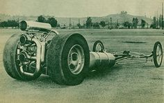 Wow...this looks like a very early turbocharged rear engine dragster