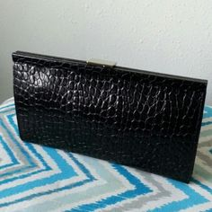 "Banana Republic Alligator Embossed Leather Clutch This NWOT Banana Republic clutch is surprisingly roomy. Photographed inside: phone, credit card & ID, cash, keys, mascara, lip gloss, pack of gum, scarf & hair tie. Original BR tag confirms it's cow leather; alligator-style embossing adds a twist. Metal closure & joints work perfectly. Measurements below, will close w/ 1.5"" worth of stuff inside. Inside zipper pocket approx. 3.25"" x 6.25"". Very light scratches on top closure (like retail…"