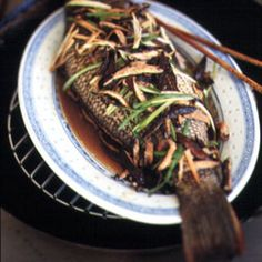 Steamed Sea Bass by Saveur. The use of the whole fish in this Cantonese-inspired dish makes for an impressive presentation. Cod Recipes, Fish Recipes, Vegetable Recipes, Seafood Recipes, Asian Recipes, Beef Recipes, Cooking Recipes, Ethnic Recipes, Lucky Food