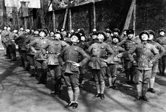 Young Chinese women undergo military training as Nationalist Chinese soldiers during the Second Sino-Japanese War. Hankou (Wuhan), Hubei, Re...