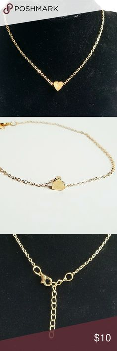 Dainty gold heart necklace Dainty heart necklace. Gold in color, adjustable with a maximum length of 16 inches. Makes a perfect pair with the heart Anklet that is also in my closet. Jewelry Necklaces