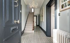 Two very different properties for you this week. First up might be a bit of a treat for all you Crittall window fans out there – yes that includes me. It was built, in as the country residence o Grey And White Hallway, Dark Hallway, Hallway Paint, Tiled Hallway, Dark Doors, Grey Doors, Coloured Skirting Boards, Grey Woodwork, Window Fans
