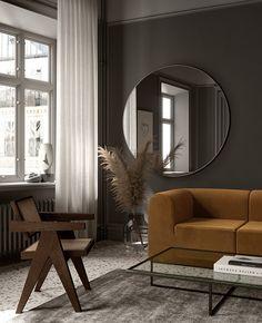 Contemporary dark gray living room with terrazzo floor by notooStudio
