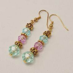 Blue, Purple & Green Pastel Beaded Dangling Earrings, Gold Spacer Beads, Flower Earings Trending Items by EverydayWomenJewelry on Etsy https://www.etsy.com/listing/238603813/blue-purple-green-pastel-beaded-dangling