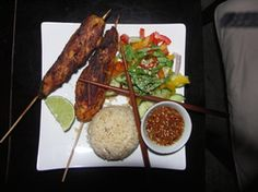 wood grilled chicken satay with coconut rice, Asian salad and hot ginger lime dipping sauce.