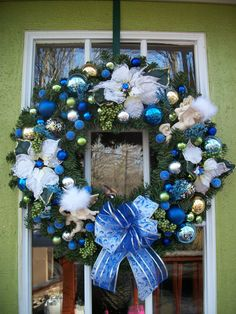 Large Christmas Wreath  with shades of blue ornaments, Angels, White Poinsettias. $85.00, via Etsy.
