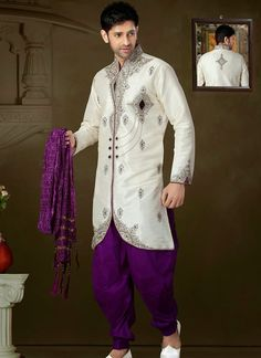 Appealing off white art silk designer sherwani is designed with sequins work, zarkan work, stone, beads and heavy zardosi work all synchronized effectively with the pattern and style and design of the...