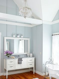 Pastel Bathroom Ideas Soaring wood-clad walls painted an appealing blue (with just a hint of gray) s Pastel Bathroom, White Bathroom Decor, Bathroom Colors, Bathroom Interior Design, Bathroom Ideas, French Bathroom, Bathroom Designs, Yellow Bathrooms, Vintage Bathrooms