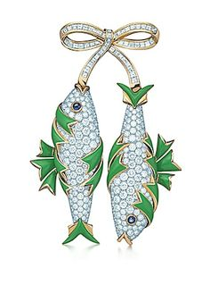 Jean Schlumberger two fish clip.   The 19th-century art of paillonné enamel, layering enamel over gold leaf, was revived and perfected on the graceful curves of this whimsical design. Clip of round brilliant diamonds, square diamonds, cabochon sapphires and green enamel in 18k gold and platinum. Round brilliant diamonds, carat total weight 8.64; square diamonds, carat total weight 2.60; cabochon pink sapphires, carat total weight .41.