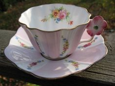 ROYAL STUART FLOWER HANDLE TEA CUP AND SAUCER
