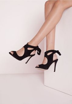 Get ahead of the shoe game this season in these stunning heeled sandals in always on trend black. In a luxurious faux suede, cut out detailing and lace up finish to the back which creates a bow, these beauts are at the top of our wish list ...