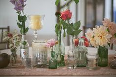 The centerpieces were a variety of vases and bottles