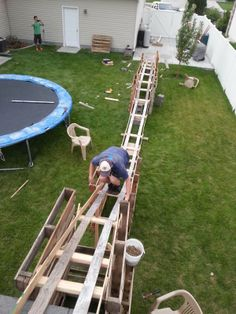 Teen Boys made their own roller coaster in back yard