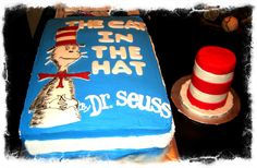 Cat In The Hat book cake with cats hat smash cake ~ 1st birthday book cake ~ Hat smash cake ~ Dr Suess.  Cakes by: Bella Baby Cakes