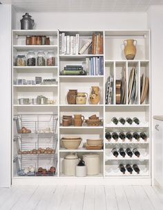 This simple storage solution includes adjustable shelves and specialized organization in a clean, white palette.