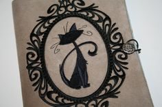 Hey, I found this really awesome Etsy listing at http://www.etsy.com/listing/126062425/cat-embroidered-vintage-kindle-cover