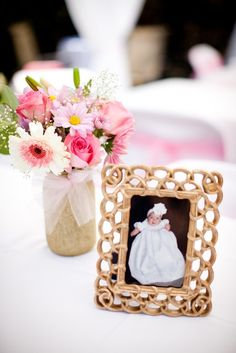 So easy to incorporate a framed photo as part of your baptism table centerpieces. The frames would be nice favors too. Use this for baby dedication . Baptism Table Centerpieces, Baptism Decorations, Flower Centerpieces, Birthday Decorations, Photo Centerpieces, Simple Centerpieces, Balloon Decorations, Christening Party, Baptism Party