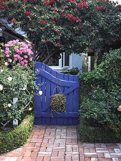 A side-yard gate painted vivid royal blue makes it stand out amid plants and flowers. A side-yard gate painted vivid royal blue makes it stand out amid plants and flowers. Garden Gates And Fencing, Garden Doors, Fence Gate, Garden Entrance, Jardin Decor, Gazebos, Arbors, Fence Design, Garden Structures