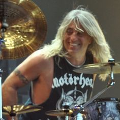 Mikkey Dee (born 31 October 1963), known better by his stage name Mikkey Dee, is a Swedish rock musician. He is the current drummer for German rock band Scorpions. Dee is best known for his time in British rock band Motörhead, with whom he played for 23 years