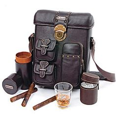 Max Benjamin Brown Leather Mini Cigar Bar - serving set in cool leather and PVC. Vintage-style hardware with lock, cedar-lined humidor, ice container, 4 high-quality acrylic cups and 3 front pockets: 164.99