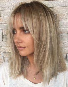 Medium Hairstyle with Feathery Ends and Bangs