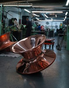 British designer Thomas Heatherwick recently launched a chair shaped like a spinning top made of spun steel and copper. The limited-edition Spun chair, produced for London gallery Haunch of Venison, is similar in form to Heatherwick's rotation-moulded plastic chair for Magis that was launched in Milan last month. Studio photos are by Peter Mallett. Production More