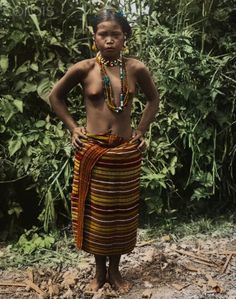 A Kalinga Igorot woman in traditional clothing poses for a portrait.