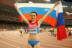Maria Kuchina of Russia celebrates after winning gold in the Women's High Jump final during day eight of the 15th IAAF World Athletics Championships Beijing 2015 at Beijing National Stadium